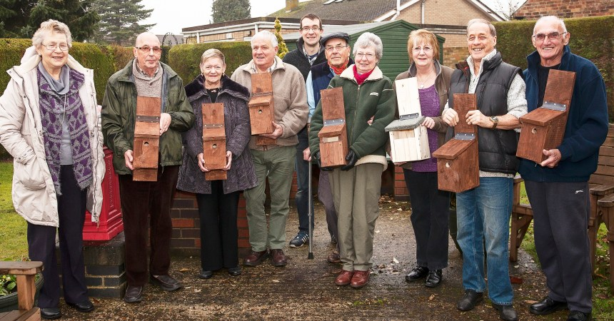 Orchard park residents with Tim Wells (centre, rear) and the bird boxes which will soon be home to spring chicks