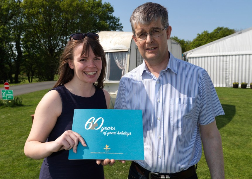 Michael Holgate with Silverdale's Jessica Douglas and a recent book celebrating 60 years of the family business