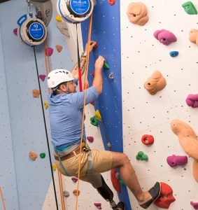 Paul gets to grips with one of 14 routes on Ladram Bay's climbing wall