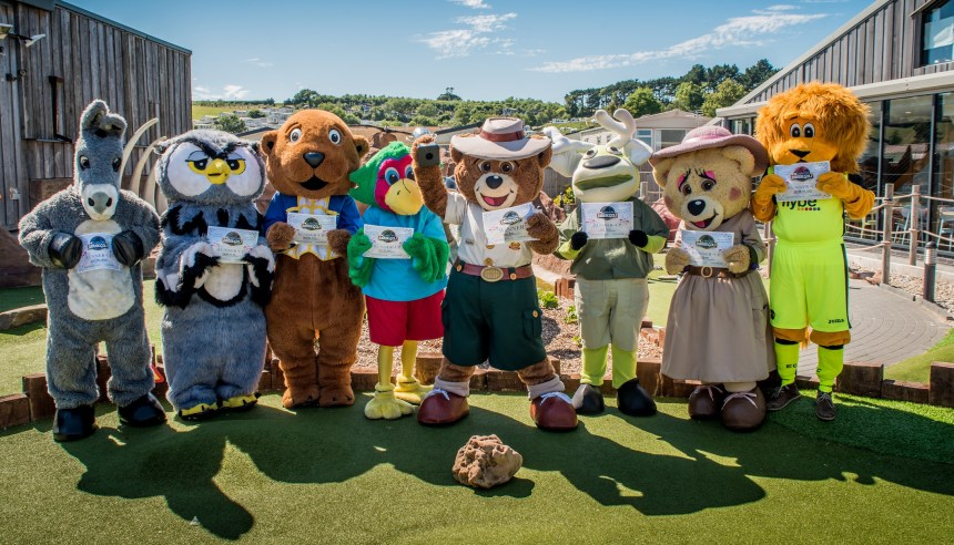 The whole in one: celebrity mascots proudly display their completion certificates at the end of the day's play