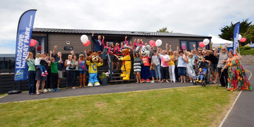 Making waves at Brixham: guests, park staff and the RNLI celebrate at the launch of the new lodge development