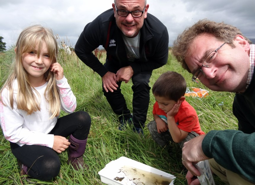 Rufus Bellamy (right) with pond-dippers young and old make aquatic wildlife discoveries at Moss Wood