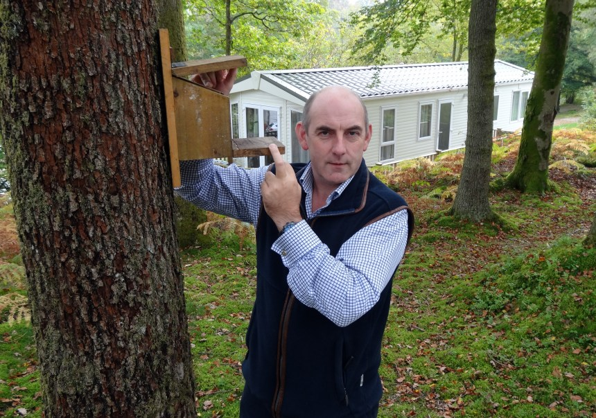 Park owner Henry Wild with one of the squirrel feeders which are spread across the 130-acre park grounds