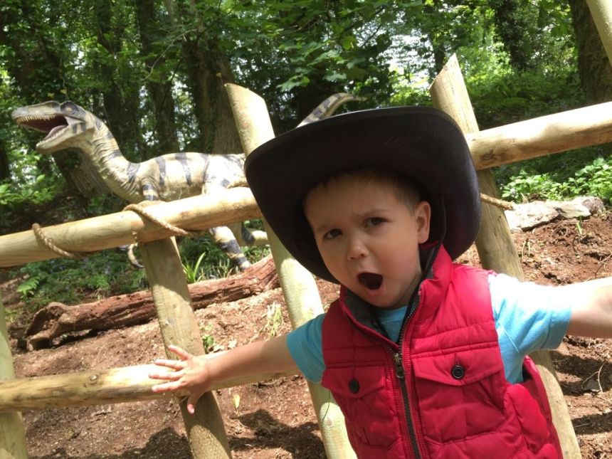 What noise does a dinosaur make? A young guest demonstrates at the park's prehistoric monster attraction