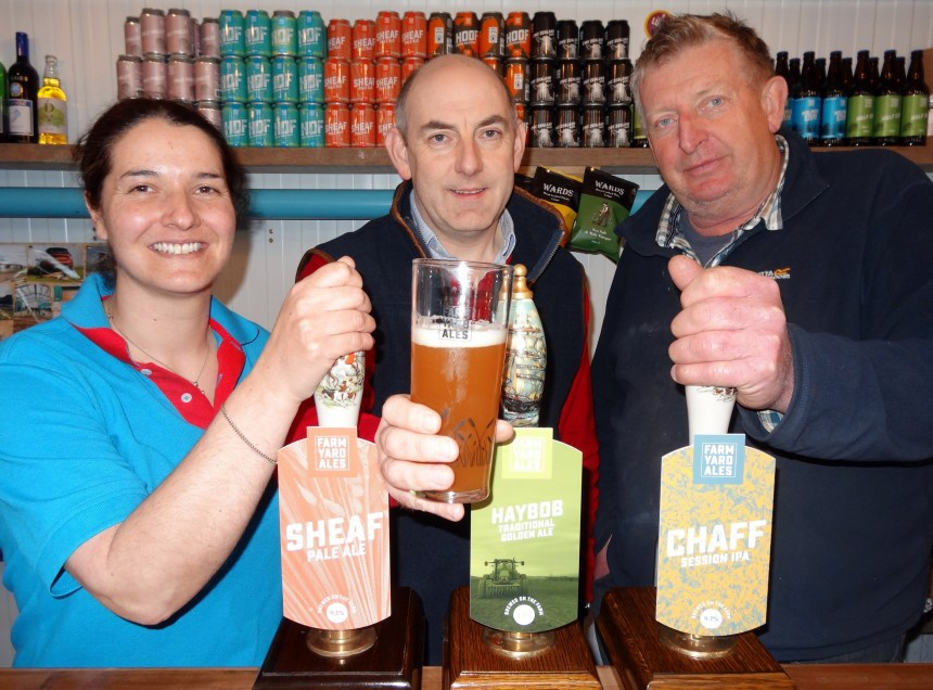 Henry Wild (centre) toasts his park's new partnership with the craft brewery's Lorna Howard and Bob Holmes
