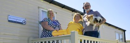 Stephen, with friend Janet and terrier Tiny, are congratulated by Harts Holiday Park general manager Donna Hough