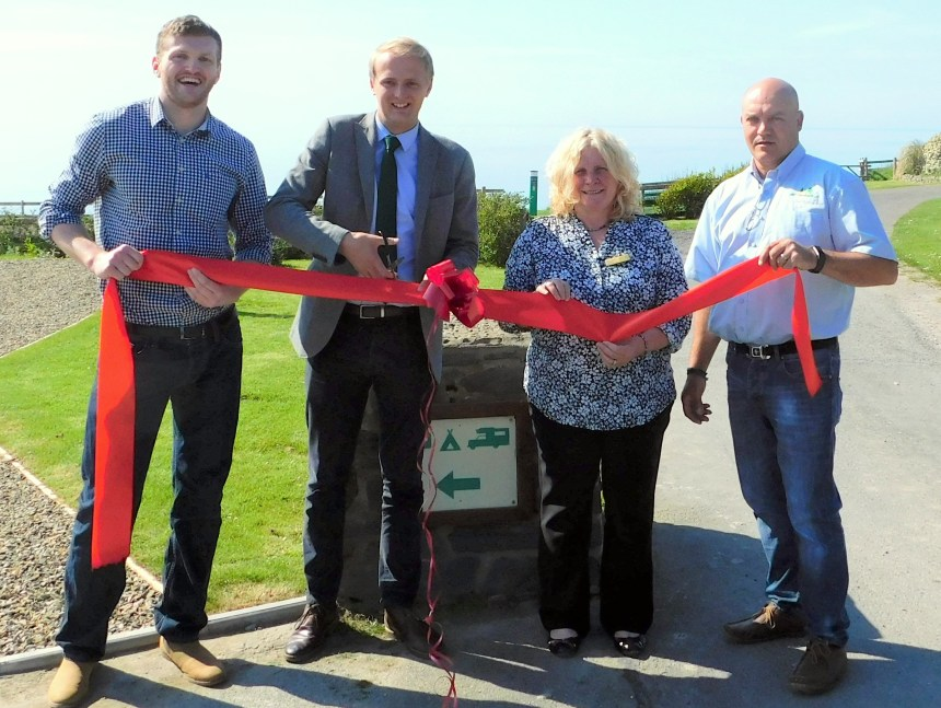 Ben Lake MP cuts the tape with (left) park owner Charles Lloyd Jones and park managers Jenny and Gary Brunt