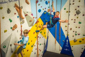 Liam can't resist a scramble on the park's indoor climbing wall