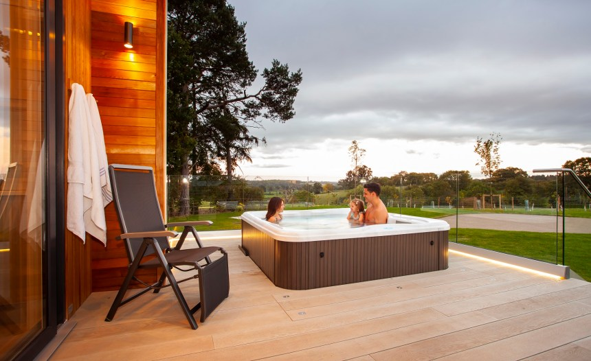 Little Olivia joins her mum Laura and dad Ben in one of the hot tubs which feature alongside the lodges