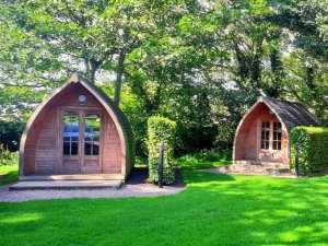 Guests' staying options include timber-built glamping pods
