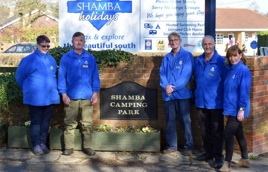 Tracey Daffern (left) and her husband Paul (centre) with the park team at Shamba Holidays in the New Forest