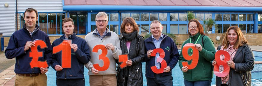 Making a big splash for charity: From the left are Hendra Holiday park director Jon Hyatt; park manager Chris North; directors Bob and Janine Hyatt, Will Dexter, Emma Wright for Macmillan Cancer Support, and director Rebecca May.