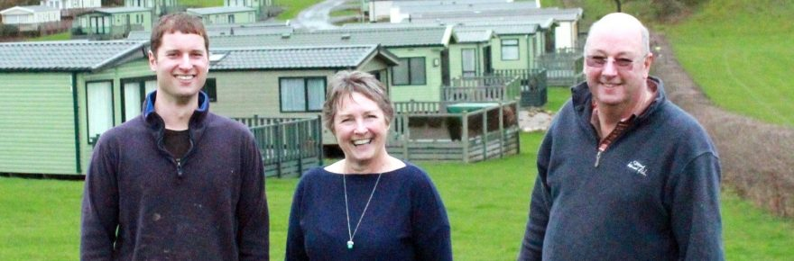 Dot and David with their son James in the grounds of Old Hall Caravan Park