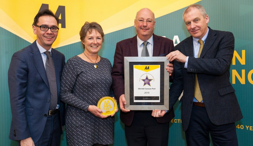 Dot and David Wightman (centre) receive their trophy and praise from judges at the recent AA award ceremony