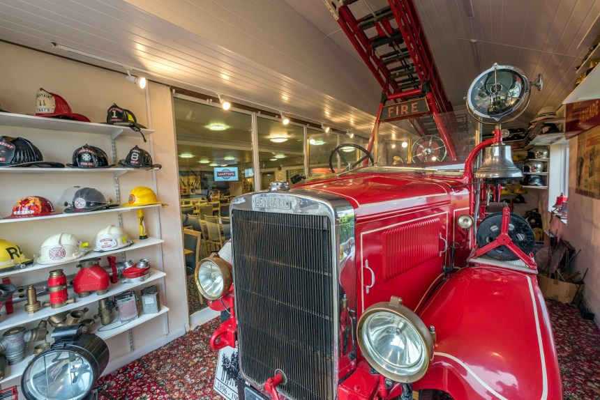 In all its gleaming glory, the restored Barkis fire engine is one of the main exhibits of fire service memorabilia in Martin's Bar which draws enthusiasts from across the UK and overseas to view its celebration of firefighting history in Dorset