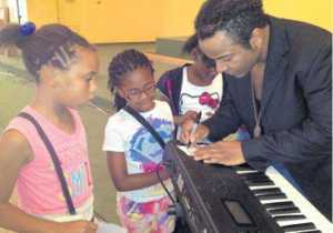 Nicholas Brooks signs autographs for Sister Thea Bowman Catholic School third-graders Brandy White, left, Gabrielle Jethro and Ja'Mya Handy. PROVIDED PHOTO/BND Read more here: http://www.bnd.com/2013/09/22/2806671/who-can-give-the-kids-hope-the.html#storylink=cpy