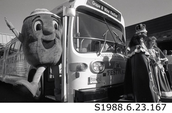 """""""Mr. Grape with Three Festival Royals and Bus,"""" 1988. STCM St. Catharines Standard, S1988.6.23.167."""