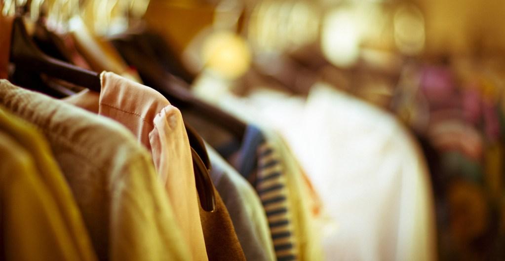 rack of clothing sitting on hangers.