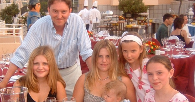 A man with his daughters at an outdoor restaurant