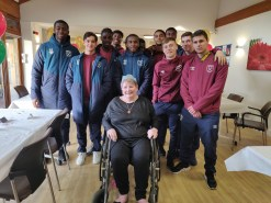 Photo 4 The Under 23 West Ham team with avid West Ham fan and St Clare Hospice Day Unit patient Lyn Whitworth, from Harlow