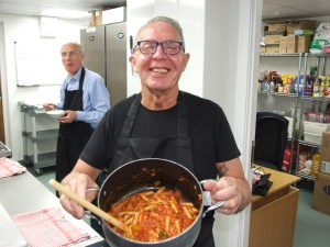Bruce Marshall enjoying cooking a penne pasta dish during the course