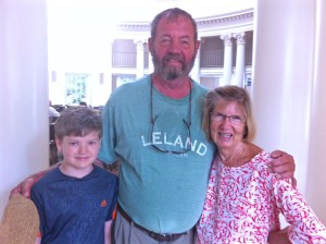 The Rev. Rodney Koopmans with his grandson Aiden Hiller and wife Janie Koopmans.