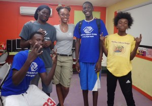 Junior Scientists in the Sea members Andy Christian, Saeed Phillips, Devonte Stevens, Elijah Thomas with Boys and Girls Club team development coordinator Thailia Rodrigues.