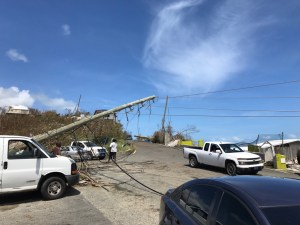 Drivers work their way around a downed pole and power lines on the road to Anna's Retreat. (James Gardner photo)