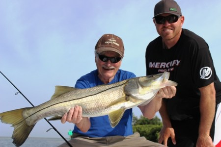 captain and client with snook