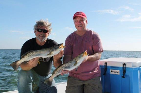 Two anglers with trout caught in Tampa FL