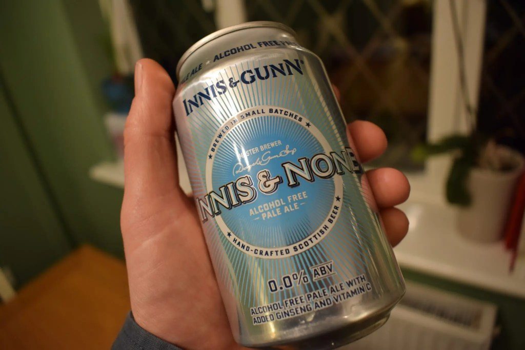 Innis and Gunn 'Innis and None' 0% pale ale can in hand