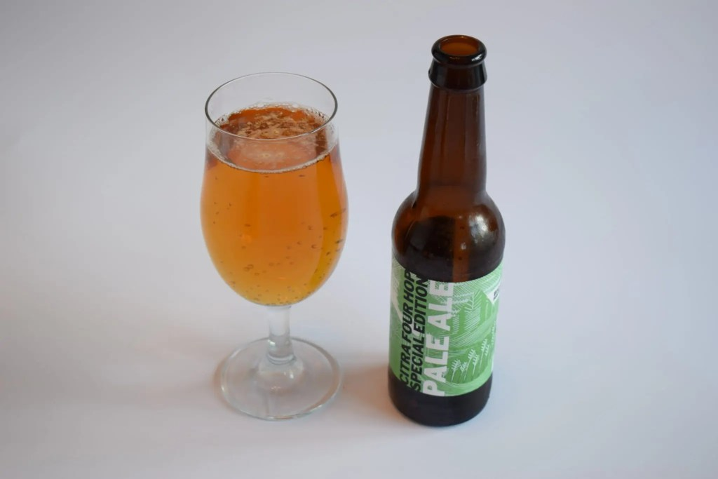Bottle and glass of Citra Pale Ale by Big Drop Brewing Co