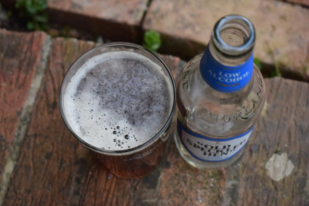 Old Speckled Hen and Old Speckled Hen Low Alcohol bottle and glass close up