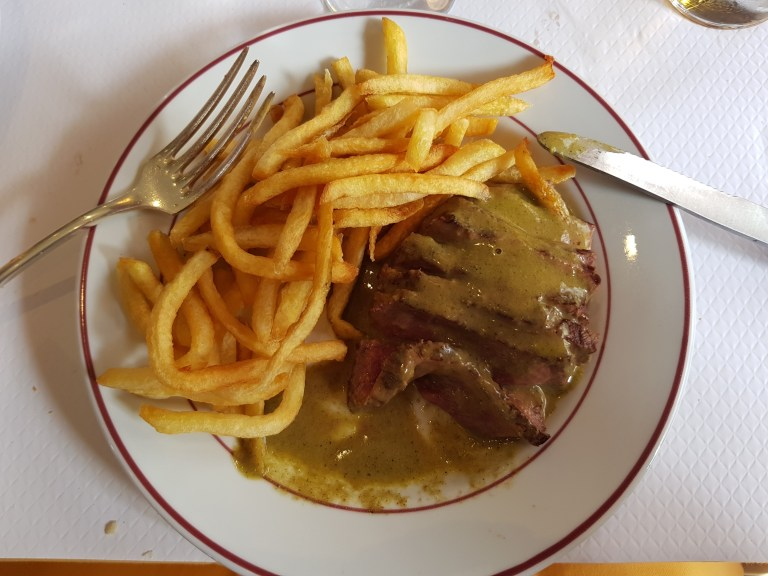 An image of steak and frites in special sauce at Le Relais de Venise