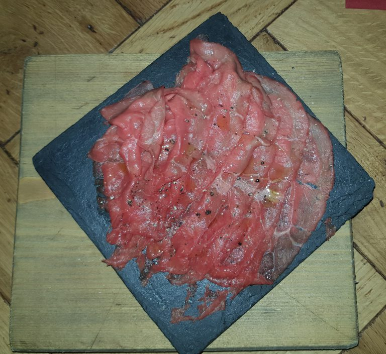 An image of beef carpaccio