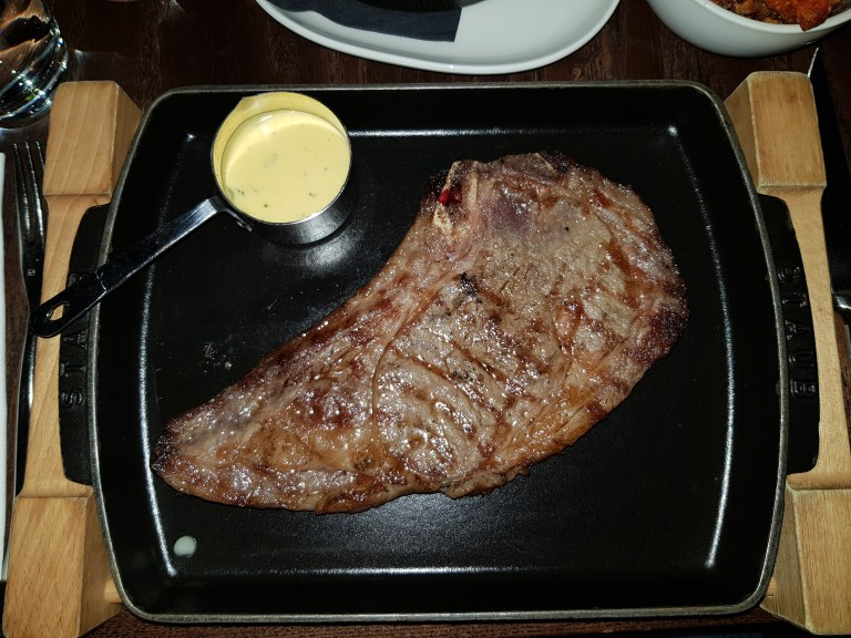 An image of Heliot Steakhouse's 'rib on the bone' extra dry aged steak