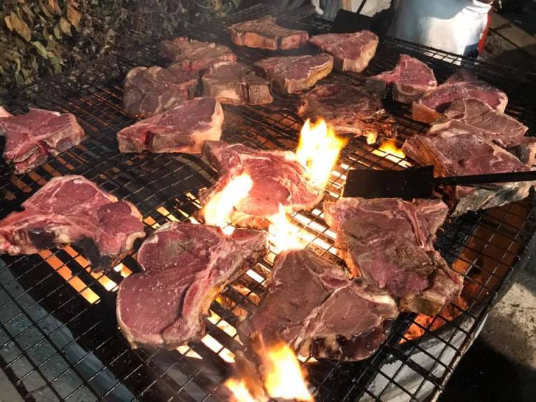 An image of T-Bone steaks being cooked at Festa della Bistecca (image from Festa della Bistecca)