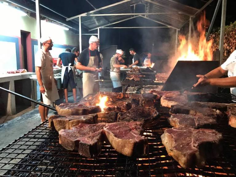 An image of T-Bone steaks being cooked for the T-Bone Challenge at Festa della Bistecca