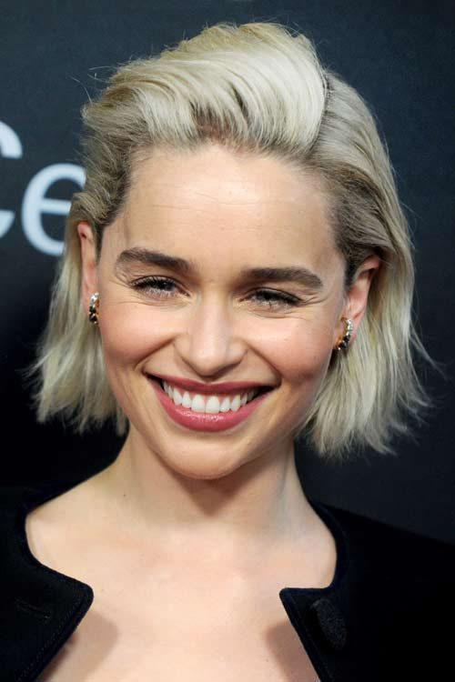 Emilia Clarke Wavy Platinum Blonde Dark Roots Hairstyle