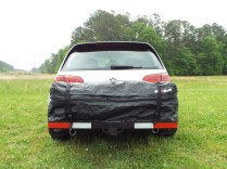 The tail lights are barely visible to other passenger cars in the zipped position (trucks/SUVs have a better view). Expanded to 11.5 cubic feet, I have no doubt that the tail lights would be completely obscured.
