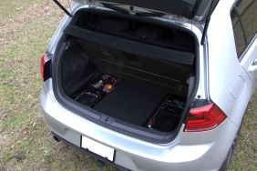 This equipment remains hidden beneath the trunk floor...