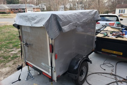 I kept the trailer covered until I was able to seal the edges with Eternabond Tape...