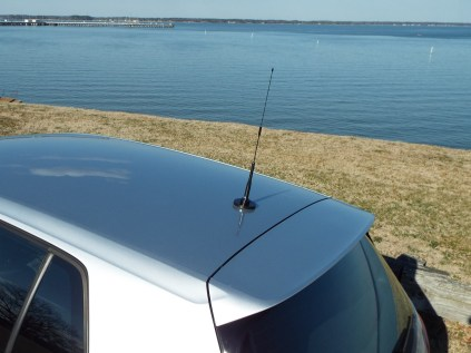 My antenna is mounted in place of the factory sharkfin antenna.
