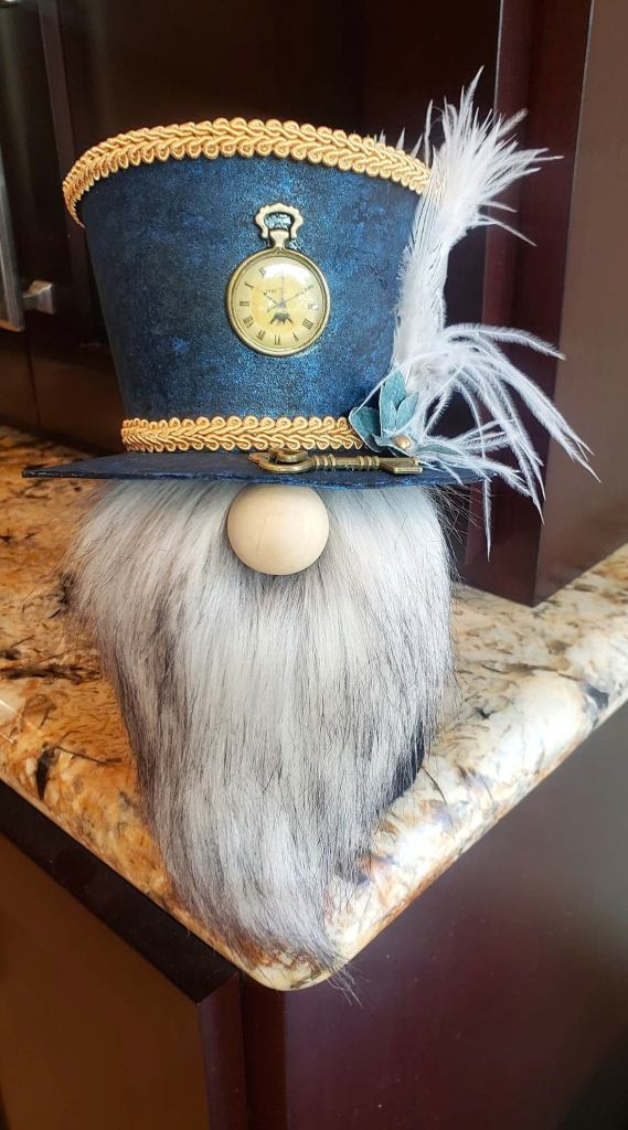 Steampunk Sock Gnome with Blue Top Hat Trimmed in Gold, Blue Flowers, White Feathers, a Key and a Clock Charm and Gray Beard