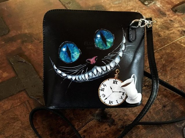 Black leather bag custom painted Cheshire Cat art. Steampunk Alice in Wonderland wow bags