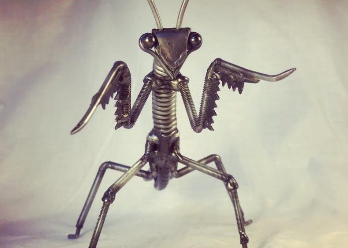 Scrap Metal Praying Mantis Sculpture.