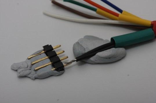 preparing to solder black wire and screen