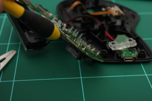 Slowly prise the old switch out whilst heating the solder