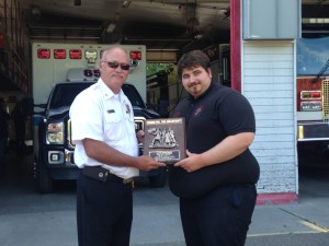 Chief Flynn presents Captain Haefner with his service recognition plaque.