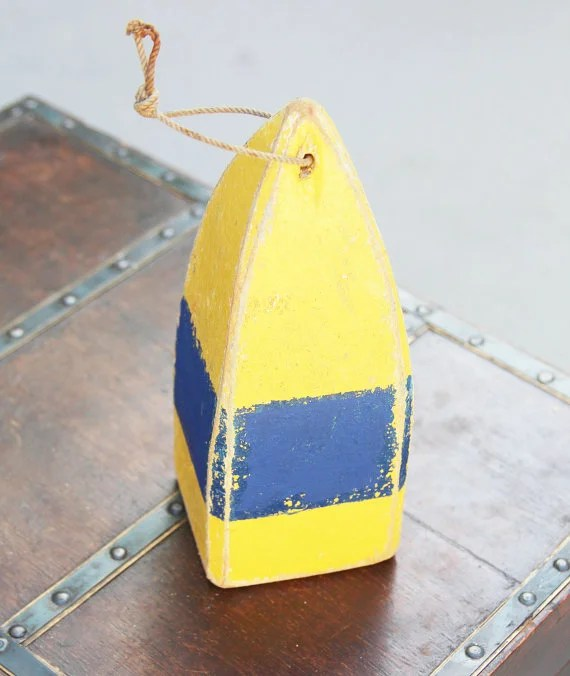 Yellow and navy blue buoy